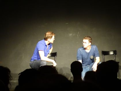 Two improv players on stage